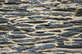 stock photo of shale  - A background image of an old shale rock wall - JPG