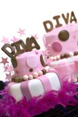 foto of diva  - Two pink fondant cakes with Diva spelled out on top and stars garnishing the front cake - JPG