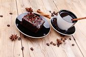 sweet food : hot black fragrant coffee and chocolate cake with cinnamon sticks, coffee beans, and an