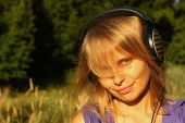 Girl listening to music in the open