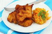 Fried cod with vegetables, close up