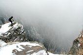 Trekker On The Summit At Winter