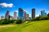 Houston Texas Skyline with modern skyscrapers and blue sky view from park lawn