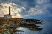stock photo of faroe islands  - Cap de Favaritx sunset lighthouse cape in Mahon at Balearic Islands of Spain - JPG