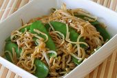 stock photo of snow peas  - Bowl of egg noodles stir fried with snow peas and beansprouts