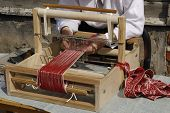 pic of loom  - An old fashioned loom on a table - JPG