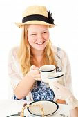 Beautiful blond teenage girl at a tea party.  White background.