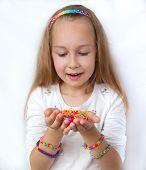 Little girl demonstrating her craft works.