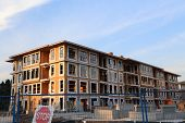 Coquitlam, BC Canada - August 24,  2014 : Brend new townhouse building with construction site in Coq