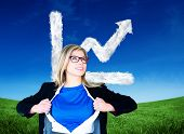 Composite image of businesswoman opening her shirt superhero style against cloud graph