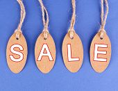 Sale tags on blue background