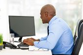 young afro american businessman working on a computer in modern office