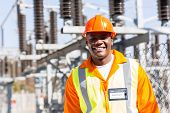 stock photo of substation  - handsome young african electrical engineer at substation - JPG