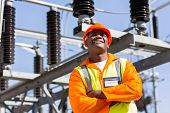 african electrical engineer with arms crossed in electricity power plant