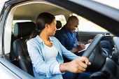beautiful african girl taking driving lessons
