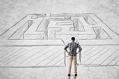 Asian man stand in front of a maze. Photo compilation with hand drawn background.