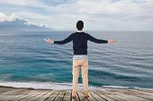 Man standing and looking the ocean, concept of relax, freedom etc.