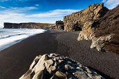 Dark sandy beach in Dyrholaey