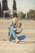 Young Woman Shooting Selfie Video With Old Analog Camera