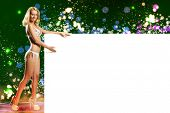 Young attractive blond in bikini holding blank banner
