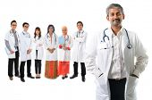 Multiracial diversity Asian medical team, expertise senior and mature doctors leading young practiti