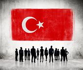 Silhouettes of Business People Looking at the Turkish Flag