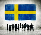 Swedish flag and a group of business people.