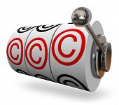 Copyright symbols or letter C on three slot machine wheels illustrating you won legal protection for