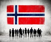 Silhouettes of Business People Looking at the Norwegian Flag