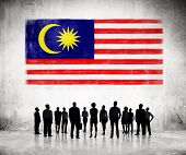 Silhouettes of Business People Looking at the Malaysian Flag