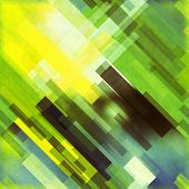 art abstract geometric diagonal seamless pattern background in green, yellow, white and black colors