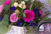 Flower Arrangement In A Basket Decorate The Wedding Table In Purple Tones. Vintage.