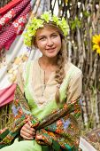 Russian beauty woman with a wreath on head