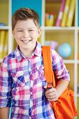 Little boy looking at camera in school