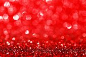 Abstract glitter bokeh holiday red background