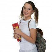 Smiling happy attractive young schoolgirl carrying a school book with her backpack over her shoulder