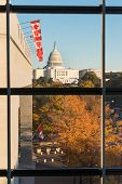 U.S. Capitol Building as seen from the windows of Newseum in Autumn - Washington D.C. United States