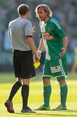 VIENNA, AUSTRIA - JULY 12 Harald Pichler (#27 Rapid) argues with referee Harald Lechner (Austria) at
