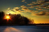 Golden sunset at a frozen lake