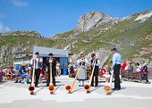 MOUNT PILATUS - JULY 13: Unidentified people preparing traditional alphorns for performance on July