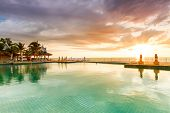 KOH KHO KHAO, THAILAND - 7 NOV 2012: Sunset at swimming pool of Andaman Princess Resort & SPA. Hotel