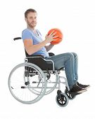 foto of paralympics  - Full length portrait of disabled player holding basketball on wheelchair over white background - JPG