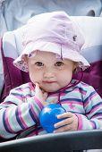 Cute Baby Girl In The Stroller