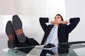 Relaxed Businessman Daydreaming In Office