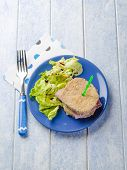 eggplant sandwich stuffed with ham and lettuce salad