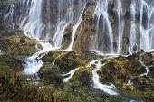 waterfall in fall, yunnan china.