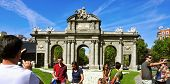 MADRID, SPAIN - AUGUST 13: Tourists taking pictures of La Puerta de Alcala on August 13, 2014  in Ma