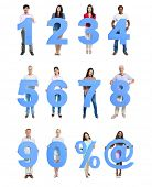 Group of People Holding Blue Numeral in a Row