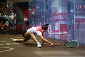 AUGUST 21, 2014 - KUALA LUMPUR, MALAYSIA: Nour El Tayeb of Egypt stretches to return in the CIMB Mal