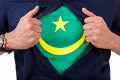 Young Sport Fan Opening His Shirt And Showing The Flag His Country Mauritania, Mauritanian Flag